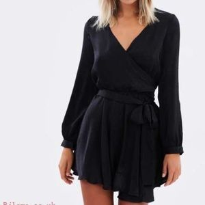 Keep on swinging black wrap dress